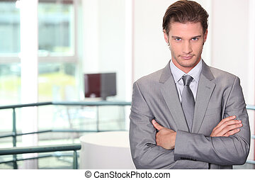Confident young male executive