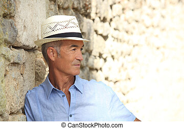 profile view of pensioner on holiday