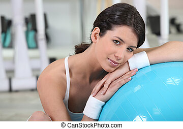 young woman reposing after fitness