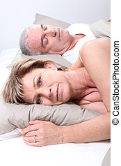 Mature couple laid in bed