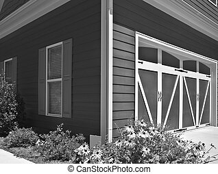 Garage Doors on House - The corner of a house showing the...