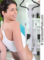 Woman laughing in a gym