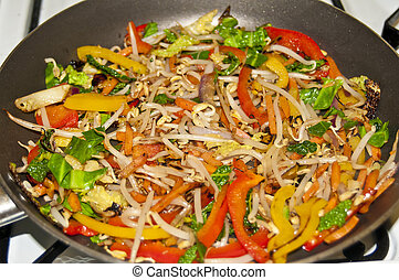 Mixed peppers and beansprout in a woc cooking