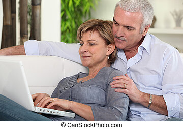 Mature couple browsing on the Internet
