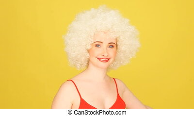 Crazy Afro Hairstyle - Humorous portrait of a young...