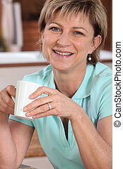 Portrait of a senior woman with a cup