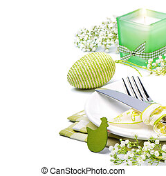 Easter table setting with candle and flowers over white