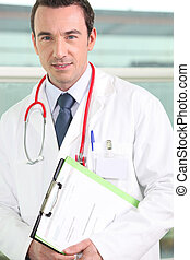Male hospital doctor holding a clipboard