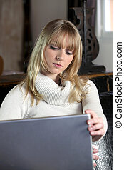Serious woman using a laptop computer