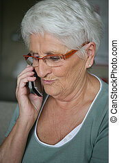 Old lady making phone call