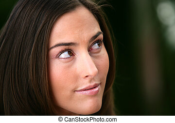 Portrait of a woman looking out of the corner of her eye