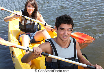 Couple paddling in a canoe