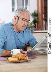 Senior man at breakfast