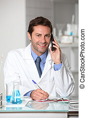 Laboratory technician on the telephone
