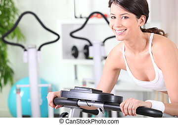 young brunette doing fitness in a fitness center