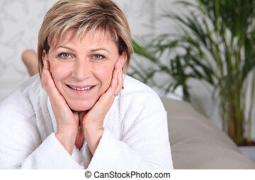 happy senior woman relaxing at home