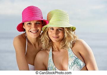 Two close female friends a the beach