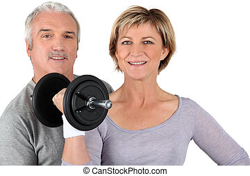 senior couple training in gym