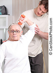 Older woman working out with a personal trainer