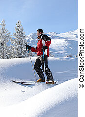 Man skiing on a sunny day