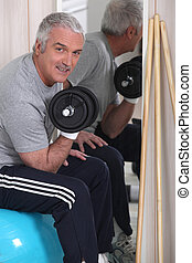 Grey-haired man lifting weights