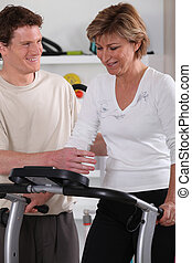middle-aged woman doing indoor sport