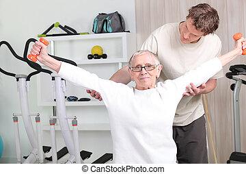 Senior woman with sports coach