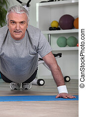 Mature man doing press ups