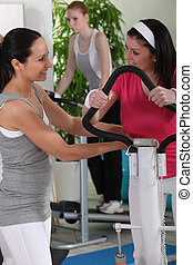 Woman gossiping at the gym