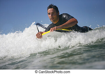 Man body boarding