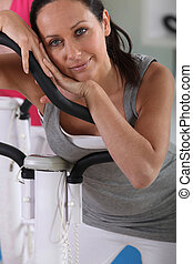 woman resting after cardio exercise