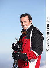 Portrait of a smiling male skier