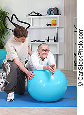 fitness coach giving a personal training to a senior lady