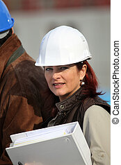 businesswoman on a construction site