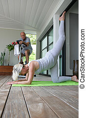 Senior people doing gymnastics at home