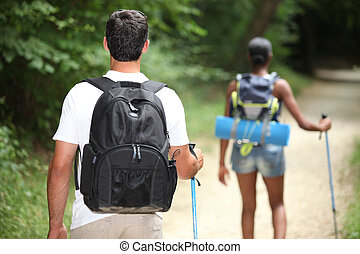 Young couple walking through countryside