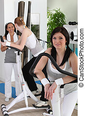 Women using gym equipment