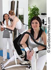 Women using gym equipment