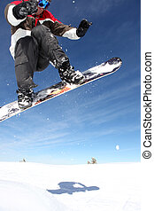 Snowboarder gliding through the air