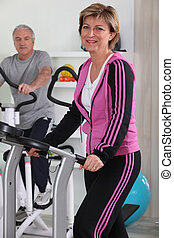 Middle-aged couple in the gym