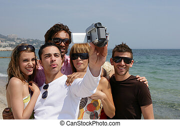 Friends on holiday with a video camera