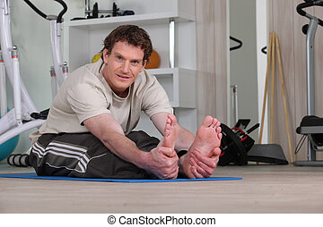 a man doing fitness at home