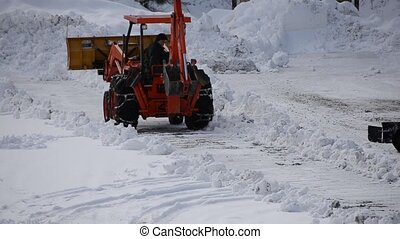 Snow plowing - Using backhoe and 4 wheeler to plow snow