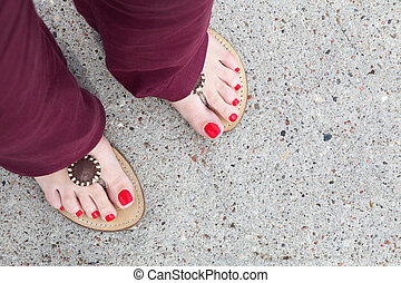 feet of a caucasian woman flip-flops - feet of a caucasian...