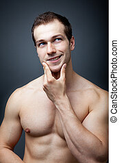 Muscles or brain? Muscular man thinking - Muscles or brain...