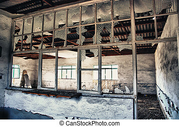 abandoned industrial factory - ruins of a very heavily...