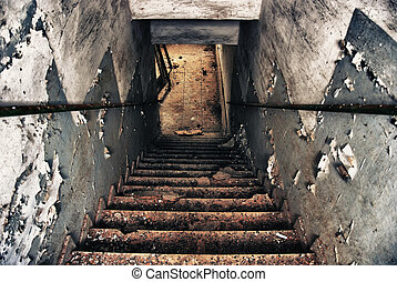 old Staircase - Staircase and exit door of an abandoned...