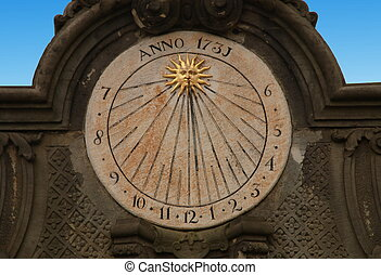 Old sundial - Sundial on the the wall. Measures time via...
