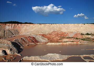 Old quarry - Old limestone quarry partially flooded with...