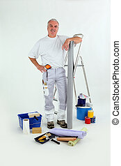 Handyman stood with step-ladder